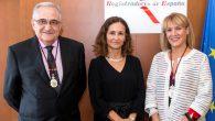 Los registradores valencianos homenajean a dos oficiales de Sueca y Aldaia